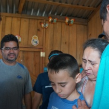 Praying with Families after installing a water filter